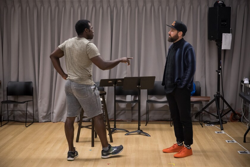 """Actor Joshua Henry, left, talks with Ross Golan, writer of """"The Wrong Man,"""" in August."""