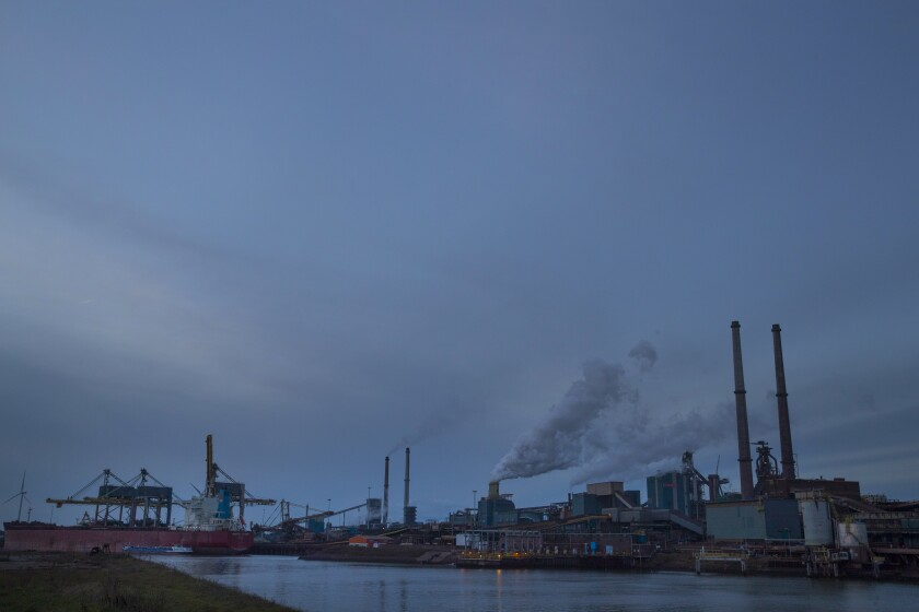FILE - In this Tuesday Dec. 4, 2018, file photo, the Tata Steel factory is seen at dusk in IJmuiden, Netherlands. The future of steel production at the sprawling plant west of Amsterdam was called into question Thursday Sept. 2, 2021, after an investigation found elevated levels of lead and other deposits in dust falling in nearby residential areas. (AP Photo/Peter Dejong, File)