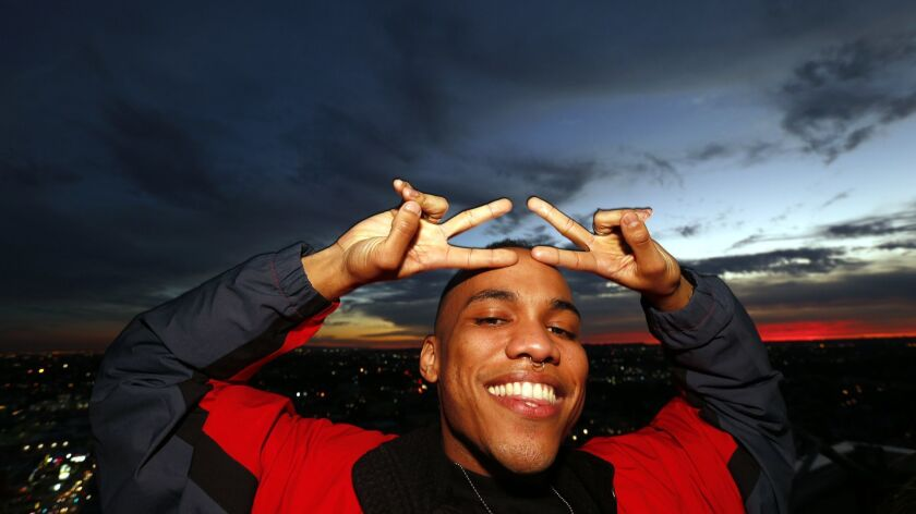 LOS ANGELES, CA - JANUARY 27, 2015 -- California born singer-rapper Anderson .Paak flashes peace sig