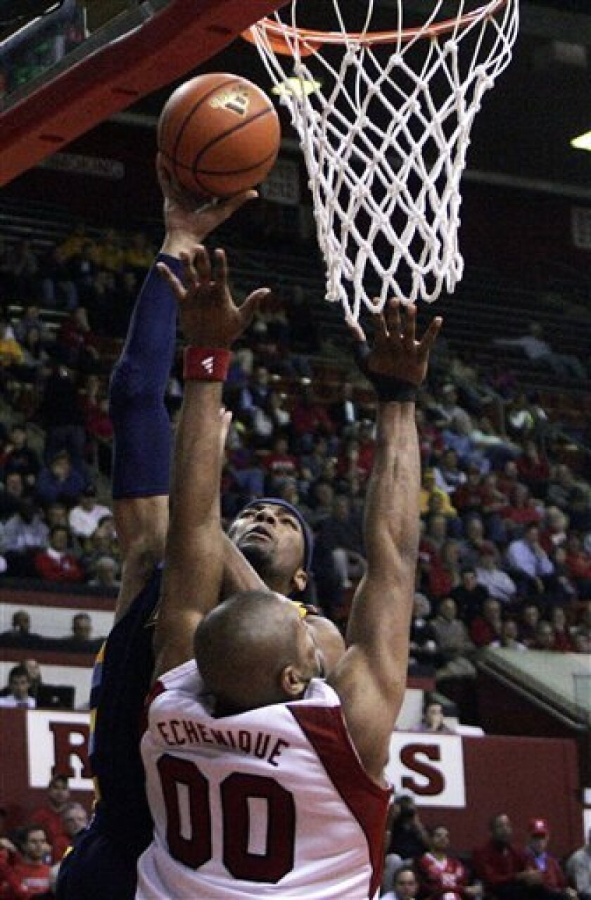 Rutgers' Gregory Echenique (00) tries to block the path of Marquette's Lazar Hayward (32)  during the first half of an NCAA college basketball game Wednesday, Jan. 7, 2009, in Piscataway, N.J.  (AP Photo/Mel Evans)