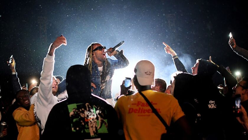 LOS ANGELES, CALIFORNIA , OCTOBER 31, 2018-Ty Dolla $ign performs during a memorial concert for Mac