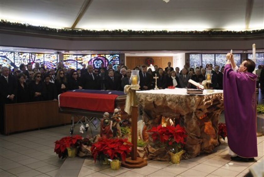 Father Alvaro Huertas says a funeral mass for the former Venezuelan president Carlos Andres Perez at the St. Thomas the Apostle Church in Miami, Wednesday, Dec. 29, 2010. Perez died Saturday at age 88. (AP Photo/Lynne Sladky)