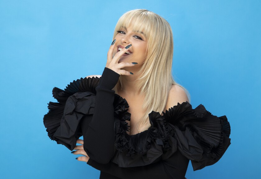 Singer Bebe Rexha in a frilly black dress.