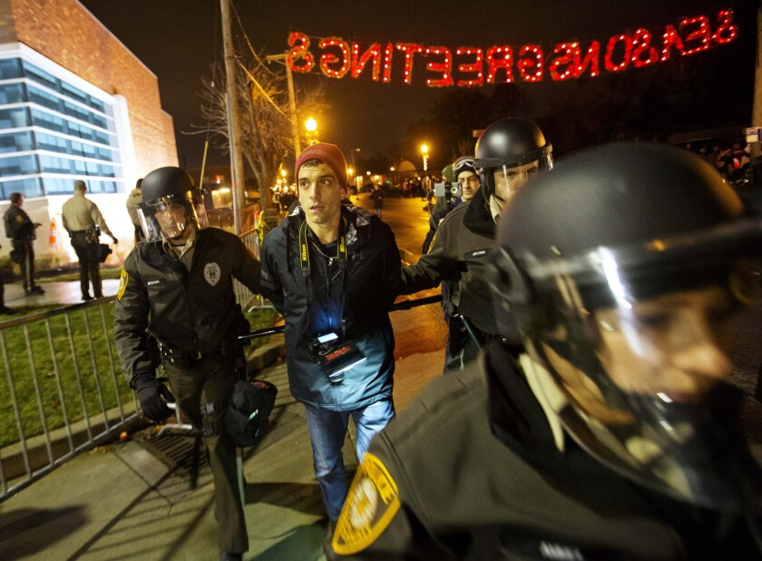Journalist Trey Yingst is arrested during a demonstration outside police headquarters in Ferguson, Mo.