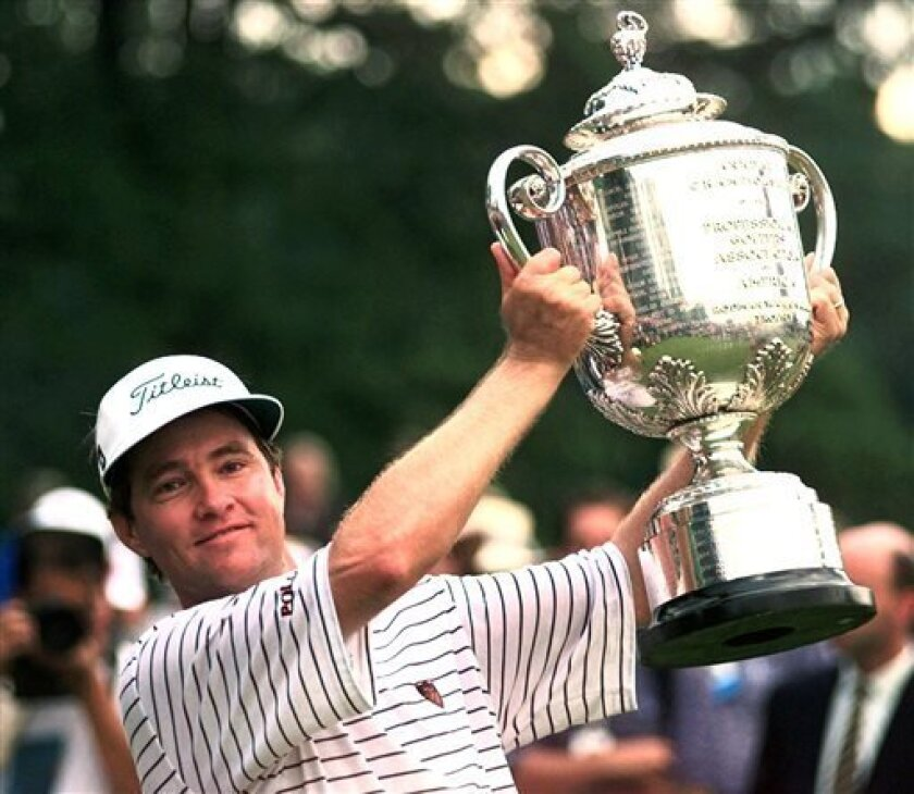 File-This Aug. 17, 1997 file photo shows Davis Love III, of Sea Island, Ga., holding up the trophy after he won the PGA Championship at Winged Foot Golf Club in Mamaroneck, N.Y. Love shot 66 in the third round and was tied for the 54-hole lead with Justin Leonard, a good friend who had won his first major a month earlier at the British Open. Love was always in control over the final round in what became a two-man race, and he finally pulled away late. (AP Photo/Elise Amendola, File)