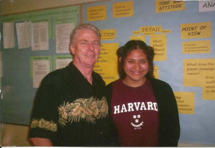 Santa Ana High School English teacher Bill Roberts poses for a photograph with student Gloria Montiel in 2005.
