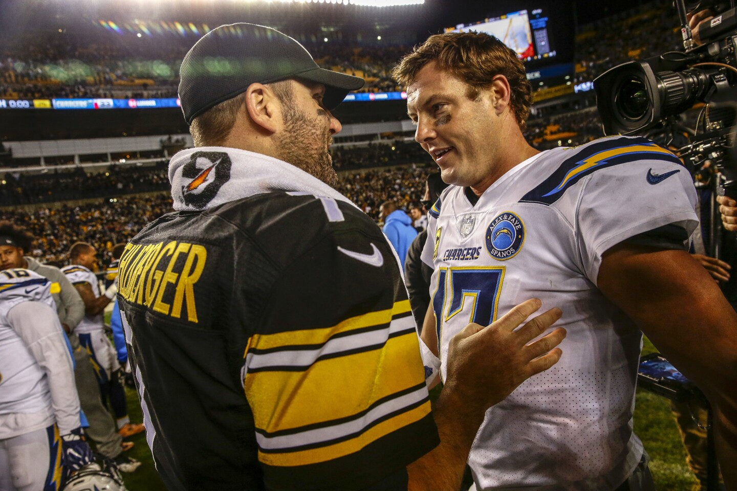 Ben Roehtlisberger and Philip Rivers meet up at the 50-yard line after a 33-30 win.