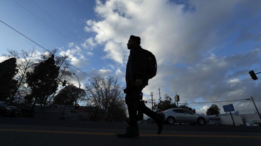 HAYWARD, CA-MARCH 1, 2018: UC Berkeley student Ismael Chamu, 21, walks the streets of Hayward, on t