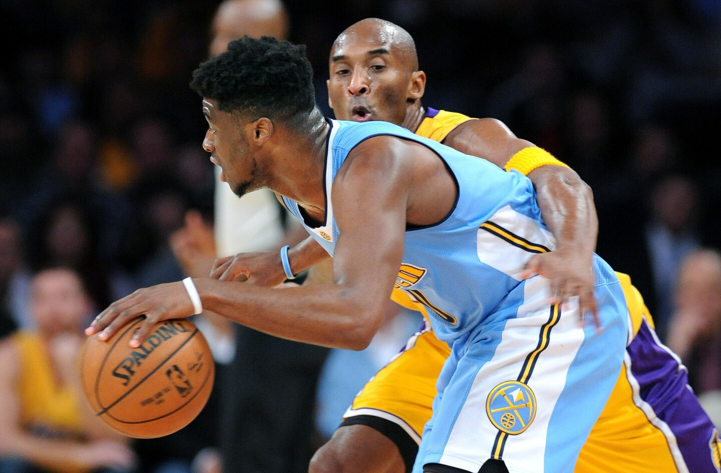 Kobe Bryant tries to steal the ball from Nuggets guard Emmanuel Mudiay at Staples Center on Nov. 3.