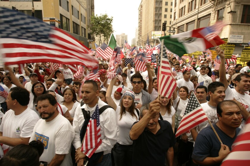 Immigrants and their supporters gather at Olympic Boulevard and Broadway in downtown Los Angeles on May 1, 2006, during a massive protest of U.S. immigration policies.