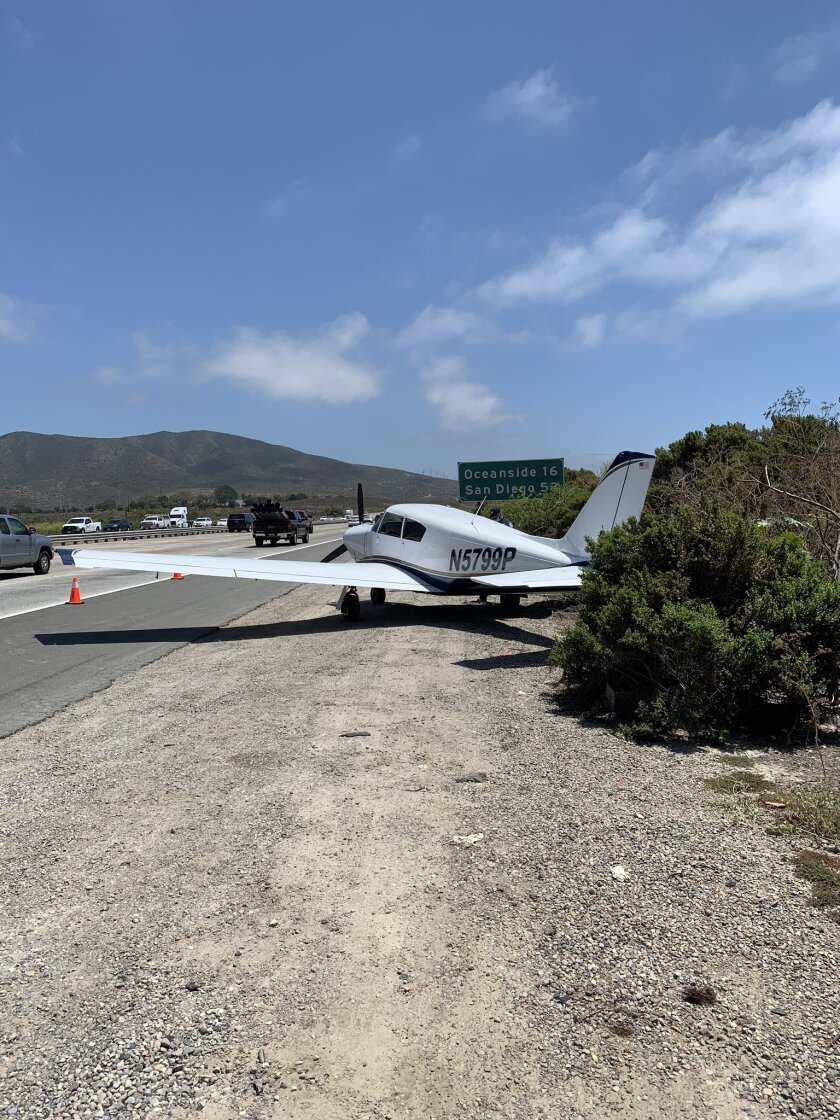 A plane sits alongside southbound Interstate 15 near San Onofre.