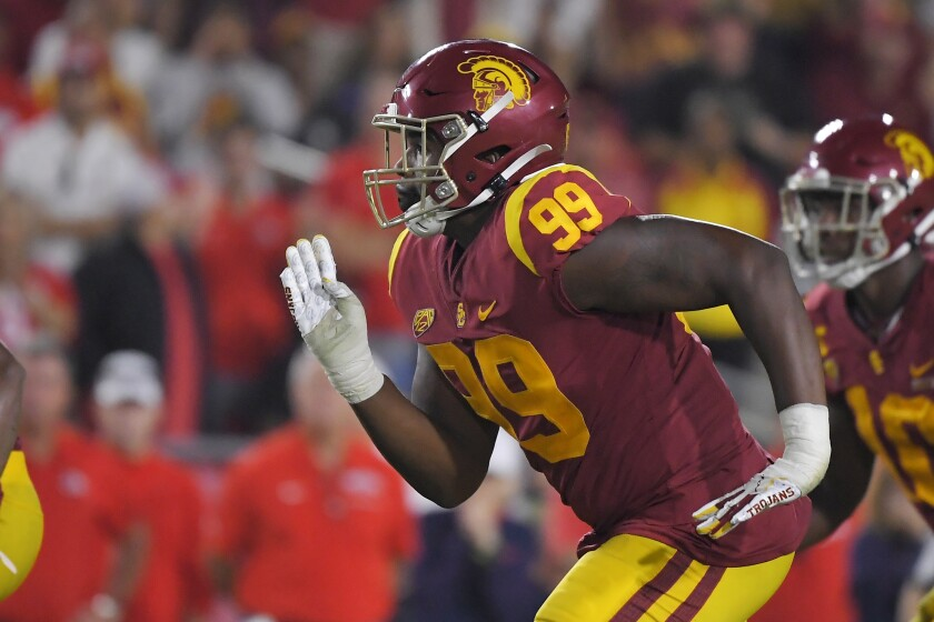 USC defensive lineman Drake Jackson runs a play during the second half against Fresno State on Saturday at the Coliseum.