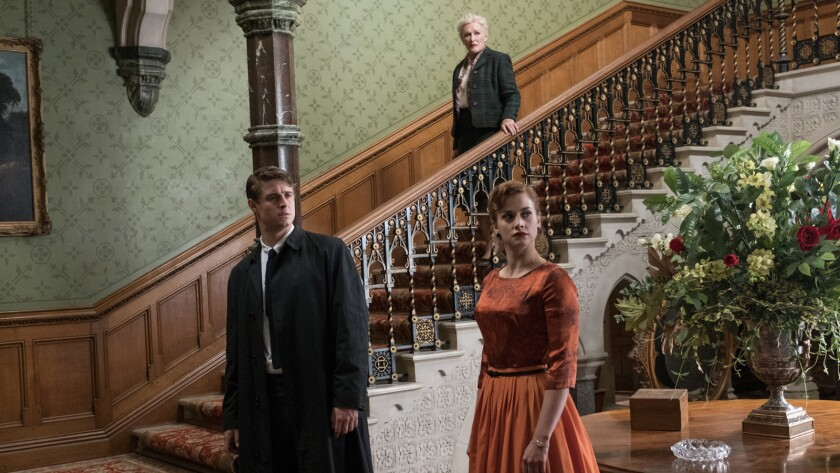 """(L-R) - Max Irons, Glenn Close and Stefanie Martini in a scene from the movie """"Crooked House."""" Credi"""