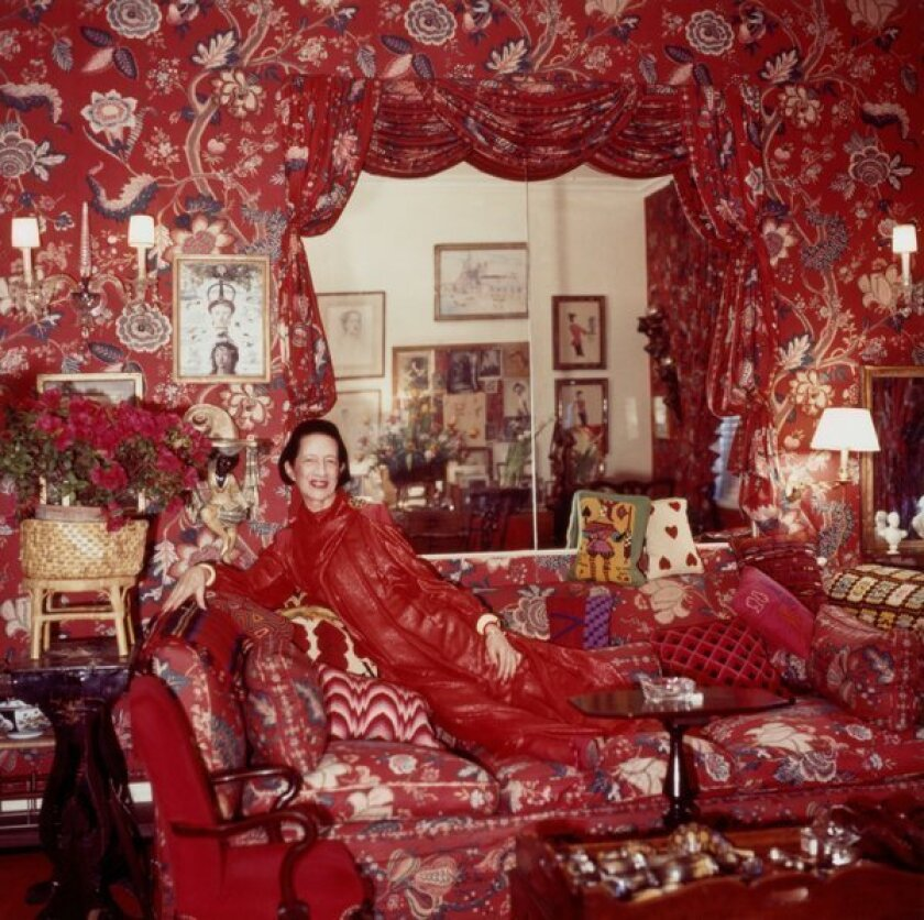 The Vogue fashion editor, shown in her living room decorated by the great Billy Baldwin, clearly never bored of red. The chintz fabric with Persian flowers was from India. Vreeland stitched some of the pillows herself.