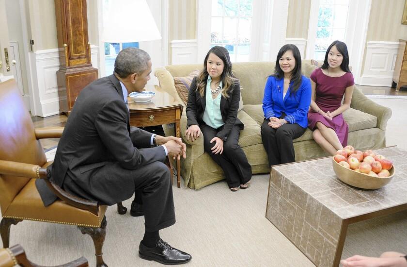 Nina Pham, Dallas nurse, with Obama