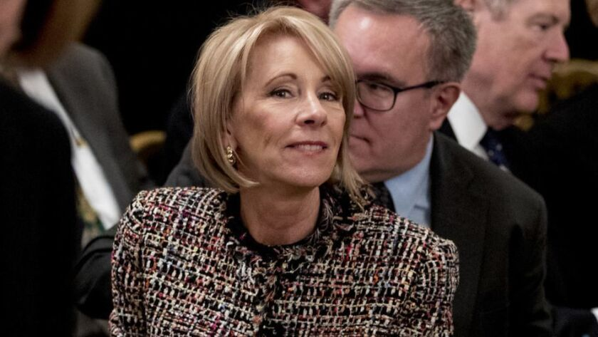 The Education Department is led by Betsy DeVos, shown Friday. The department found that Navient, one of the nation's largest student loan servicing companies, may have driven tens of thousands of borrowers struggling with their debts into higher-cost repayment plans.