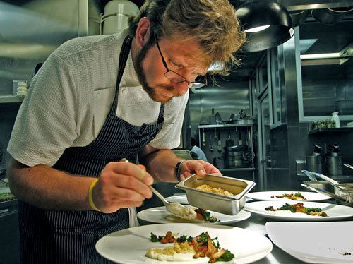 Chef/owner Michael Cimarusti plates food in the kitchen of Providence.