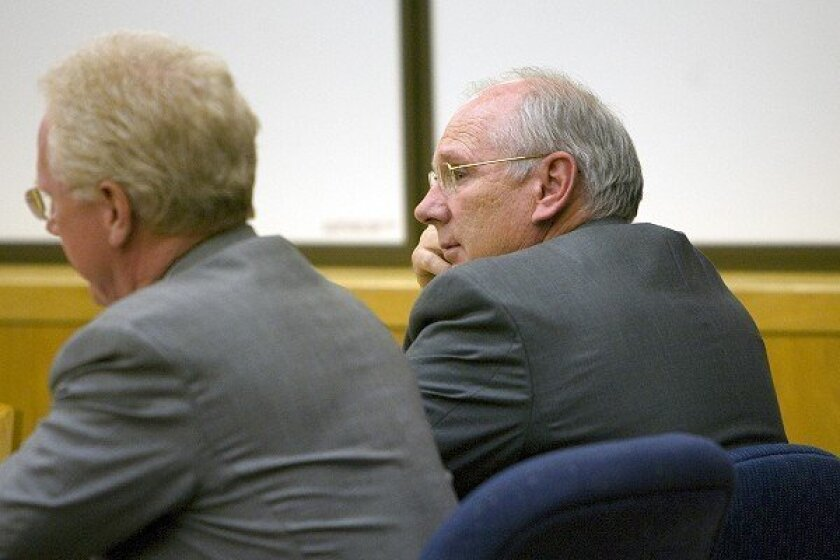 Joseph Orlosky (right) listens to the verdict Friday with his attorney, Paul Pfingst.