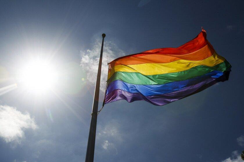 The Hillcrest Pride Flag flies at half-mast.