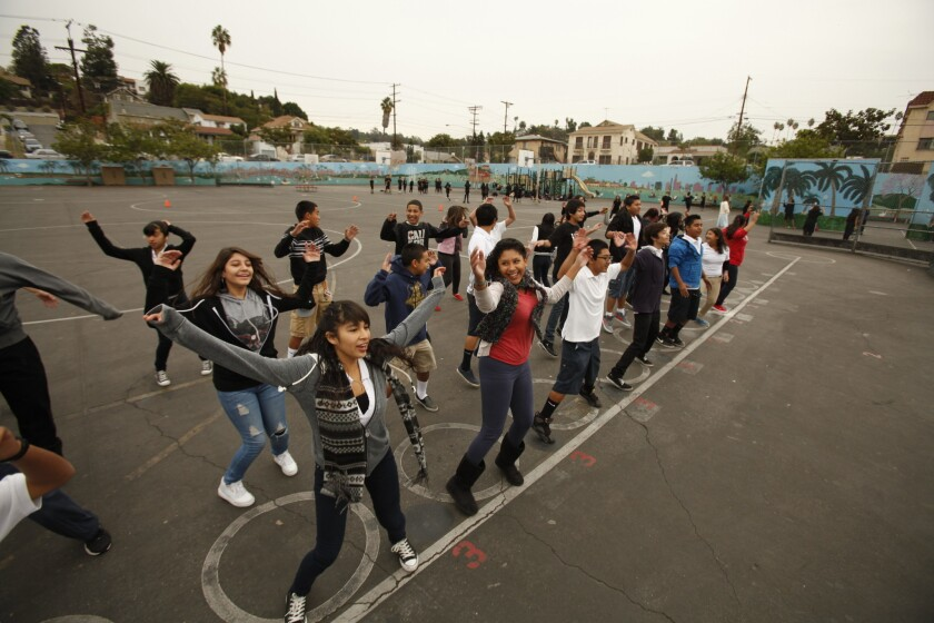 Eighth-grade students work out at Logan Street Elementary School in Echo Park. A new study finds that American adolescents get the bulk of their exercise at school, but still fall short of official targets for physical activity.