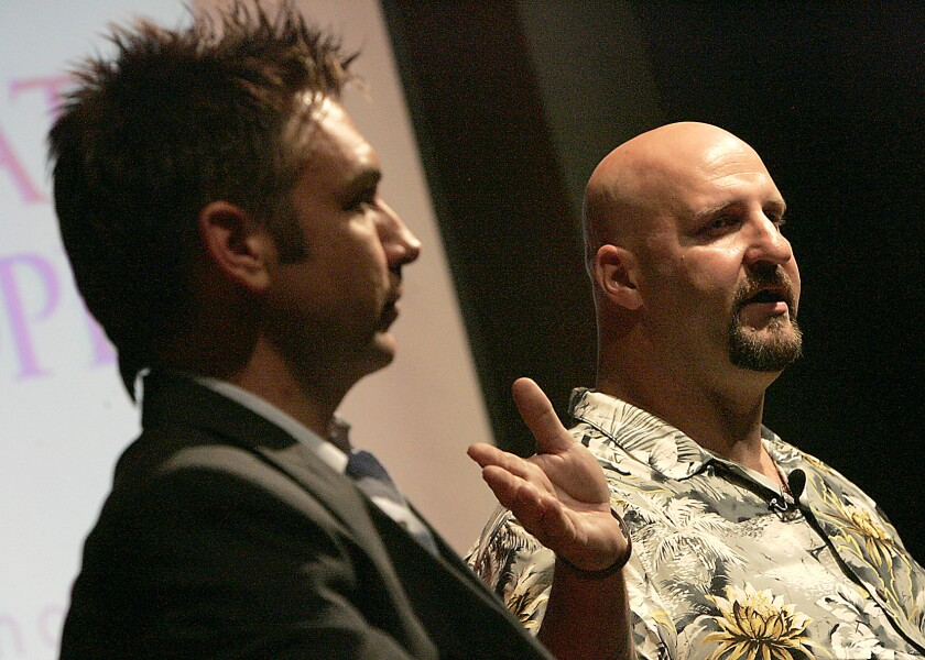 Matthew Boger, a gay man, left, and Tim Zaal, a former neo-Nazi who beat him years ago, strike up an odd friendship. They both work at the Museum of Tolerance now. They spoke there in 2006 about their experiences.
