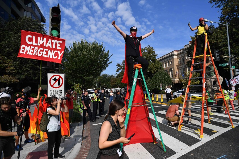 Environmental activists block an intersection in Washington on Sept. 23.