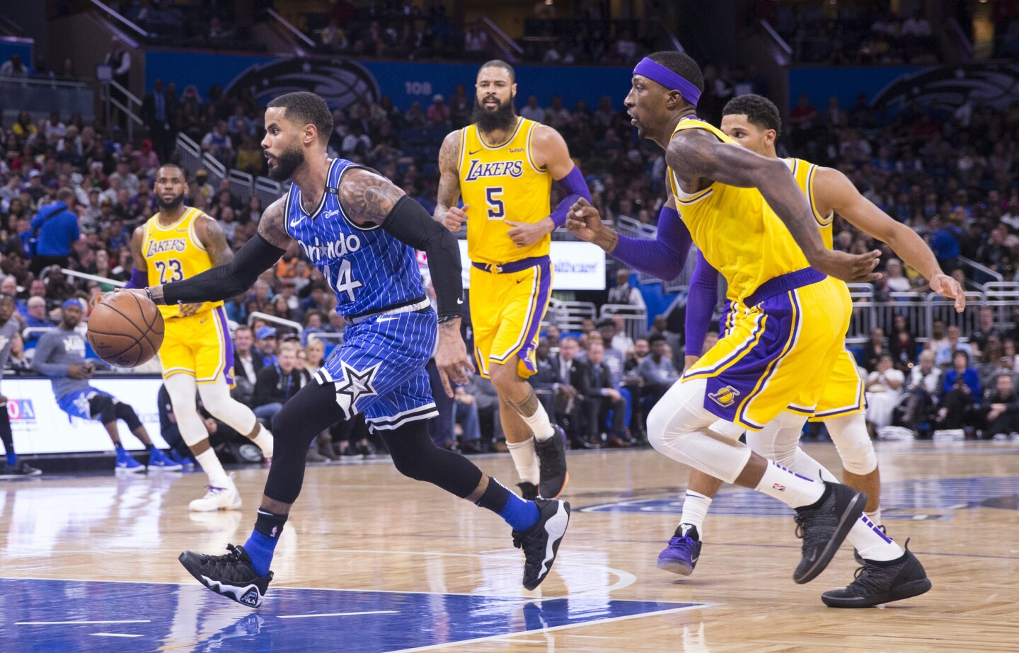 Orlando Magic guard D.J. Augustin (14) dribbled past Los Angeles Lakers guard Kentavious Caldwell-Pope, right, and center Tyson Chandler (5) during the second half of an NBA basketball game, Saturday, Nov. 17, 2018, in Orlando, Fla. The Magic won 130-117. (AP Photo/Willie J. Allen Jr.)