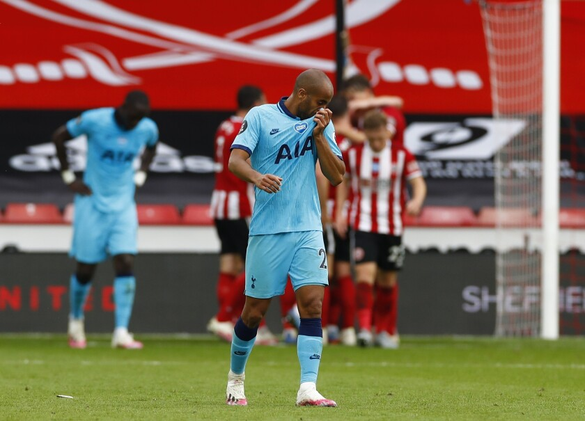 Tottenham players react after the second goal of Sheffield United during the English Premier League soccer match between Sheffield United and Tottenham Hotspur at Bramall Lane in Sheffield, England, Thursday, July 2, 2020. (Jason Cairnduff/Pool via AP)