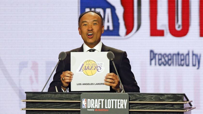 NBA Deputy Commissioner Mark Tatum announces that the Los Angeles Lakers had won the fourth pick dur