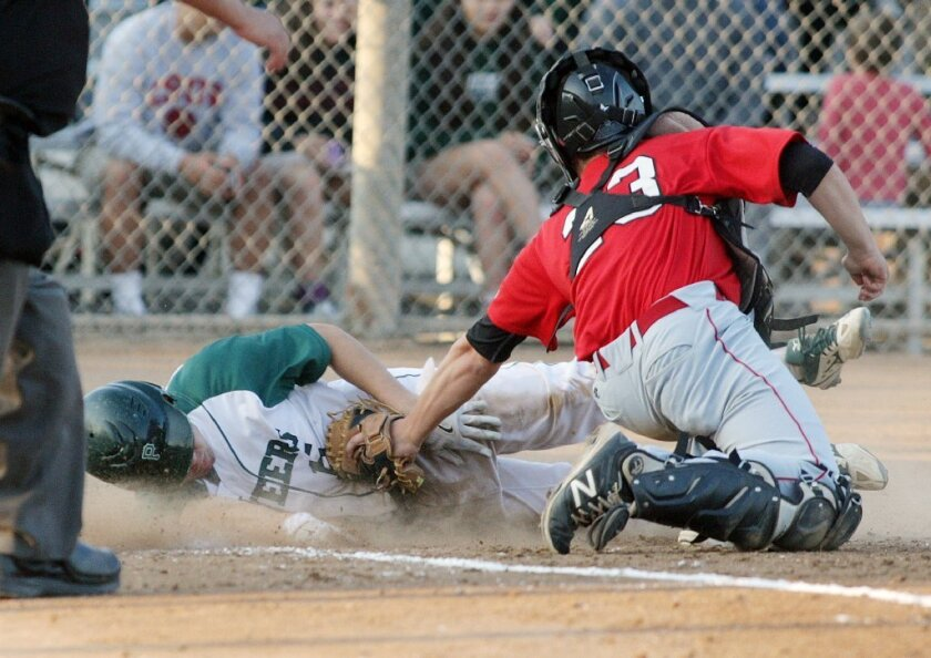 Providence's Sage Del Castillo safely avoids the tag to score a run against Buckley.