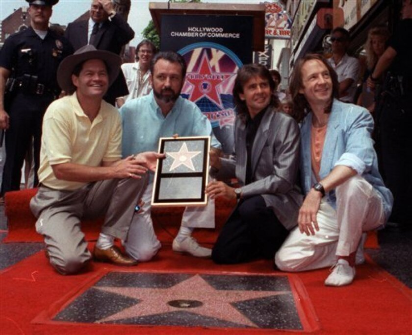 FILE - In this July 10, 1989 file photo, The Monkees, from left: Micky Dolenz, Mike Nesmith, Davy Jones and Peter Tork  get a star on the Hollywood Walk of Fame in Los Angeles. Jones died Wednesday Feb. 29, 2012 in Florida. He was 66. Jones rose to fame in 1965 when he joined The Monkees, a British