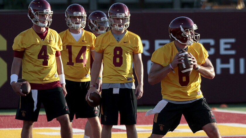 Ricky Town (8) waits in line during a passing drill at USC as Cody Kessler (6) takes his turn on Aug. 8, 2015.