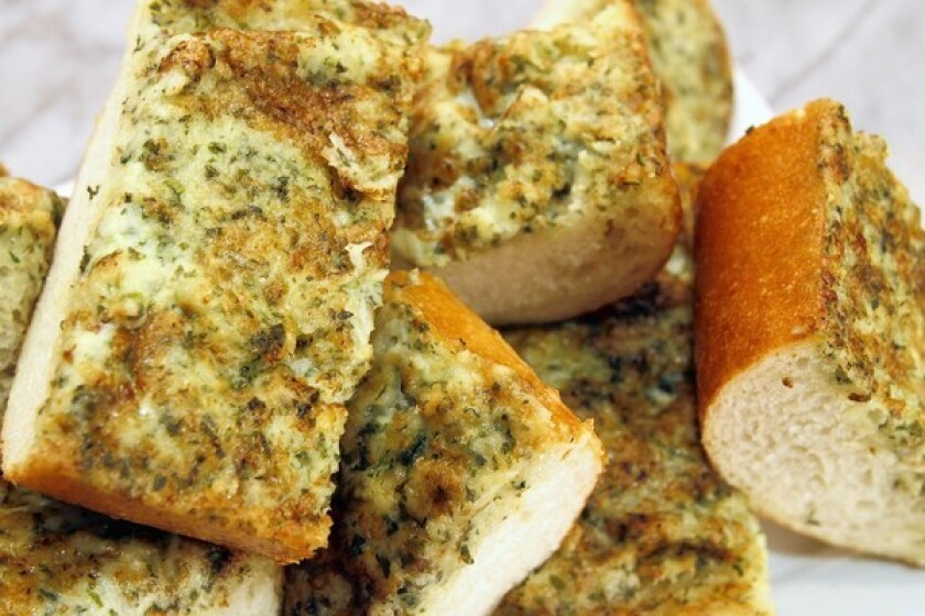 The garlic bread made at Cedar Creek is topped with lots of Parmesan cheese. Recipe: Cedar Creek's garlic bread