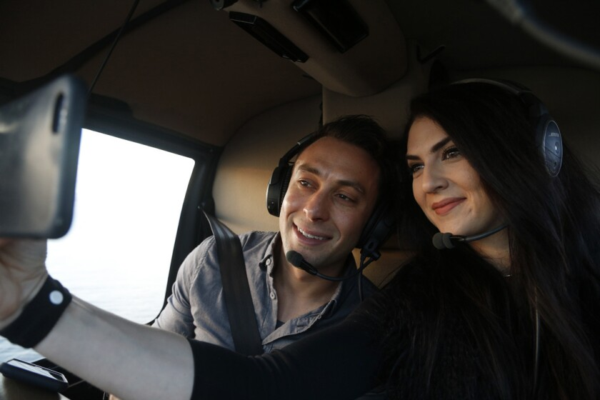 Blind daters Scott Schindler and Zlata Sushchik take a selfie together while flying over San Diego on a Romance Tour provided by Corporate Helicopters.