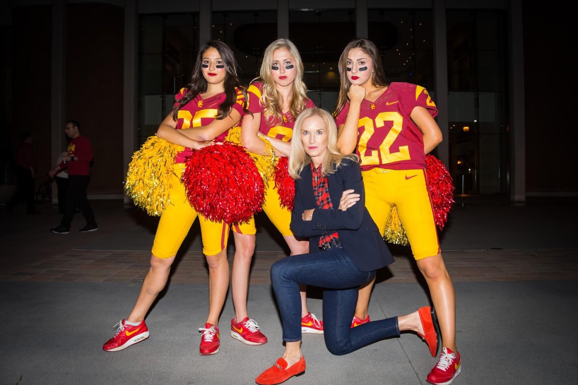 From L-R, Aya Shimizu, Lauren Dunn and Adrianna Robakowski pose with Lori Nelson.