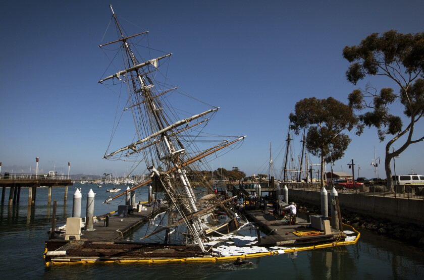 An old-fashioned sailing ship, sinking