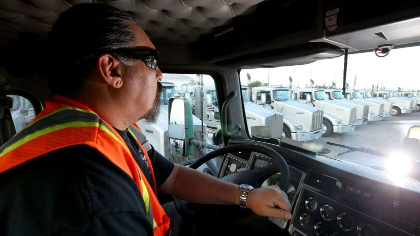 A trucker maneuvers his big rig around the Shippers Transport Express yard in Carson on Sept. 20, 2016.