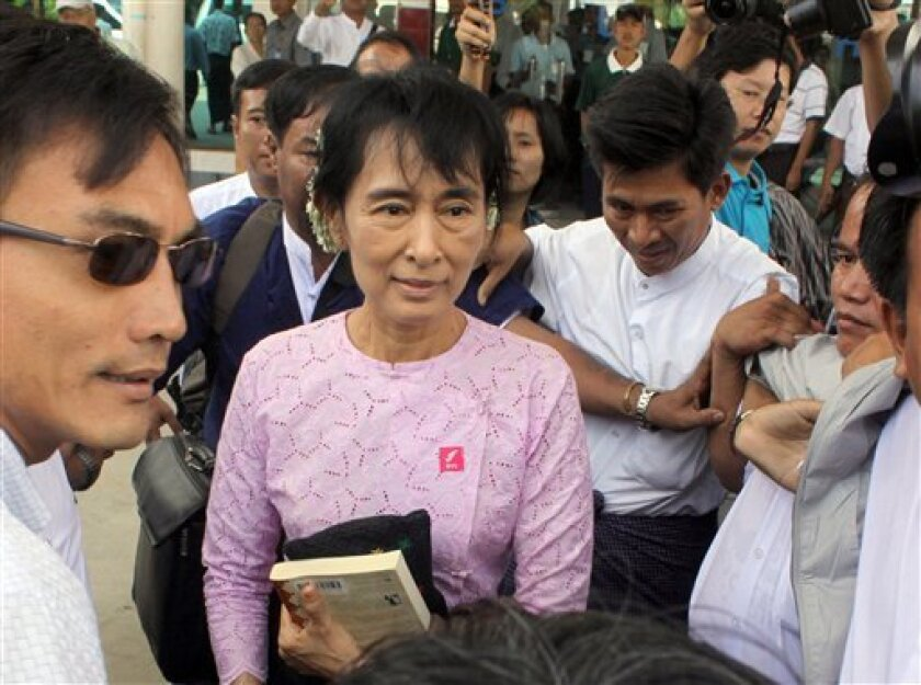 Myanmar democracy icon Aung San Suu Kyi arrives at Nyaung Oo airport in Bagan, Myanmar Monday, July 4, 2011. Suu Kyi made her first trip into the countryside since her release from house arrest last November. (AP Photo/Khin Maung Win)