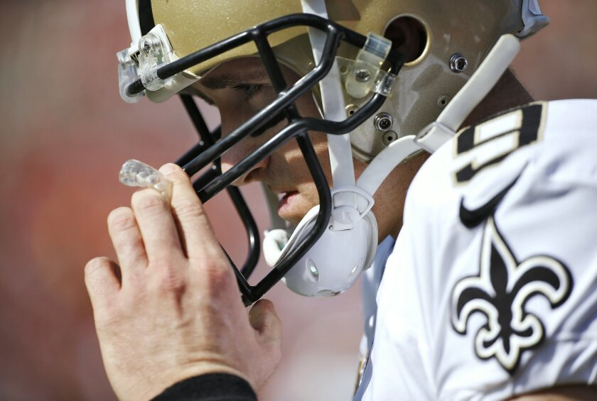 FILE - In this Dec. 28, 2014, file photo, New Orleans Saints quarterback Drew Brees pauses during an NFL football game against the Tampa Bay Buccaneers in Tampa, Fla. Brees said he hopes the teams overhaul has strength the team in the areas of leadership, chemistry, and attention to detail. (AP Photo/Brian Blanco, File)