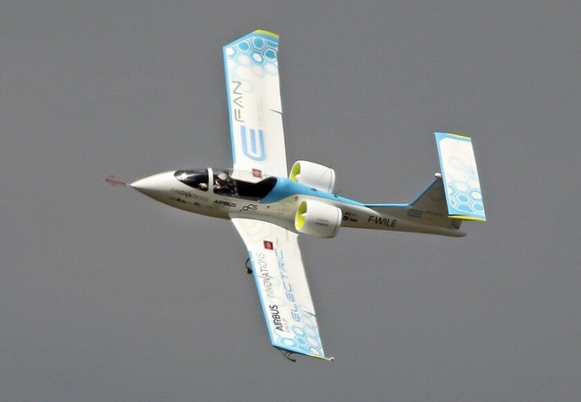 An Efan 1 electric plane performs its demonstration flight at the Paris Air Show in Le Bourget, north of Paris, Friday, June 19, 2015. The Efan is a two-seat experimental electric aircraft developed by Airbus Group and partners. Some 300,000 aviation professionals and spectators are expected at thi