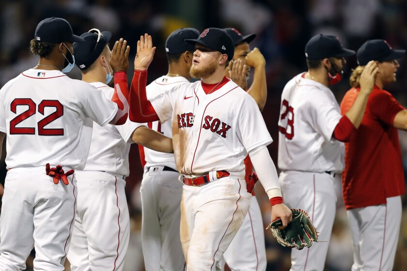 Boston Red Sox's Alex Verdugo, center, celebrates with teammates after defeating the Miami Marlins in a baseball game, Monday, June 7, 2021, in Boston. (AP Photo/Michael Dwyer)