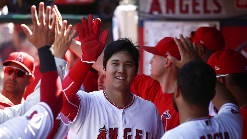 Angels pitcher Shohei Ohtani (17) celebrates in the ninth inning against the Oakland Athletics at Angel Stadium on Sept. 30, 2018.