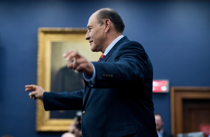 Rep.-elect Lou Correa (D-Santa Ana) reacts after drawing the No. 1 chip during the new member office lottery at the Capitol.