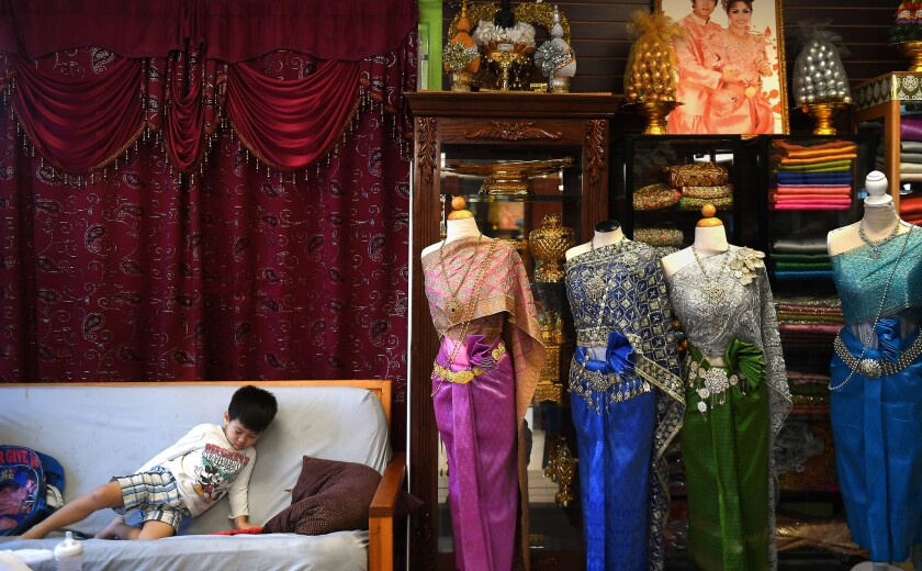 Skyler Khy, 3, left, hangs out at his mother's salon in Cambodia Town in Long Beach.