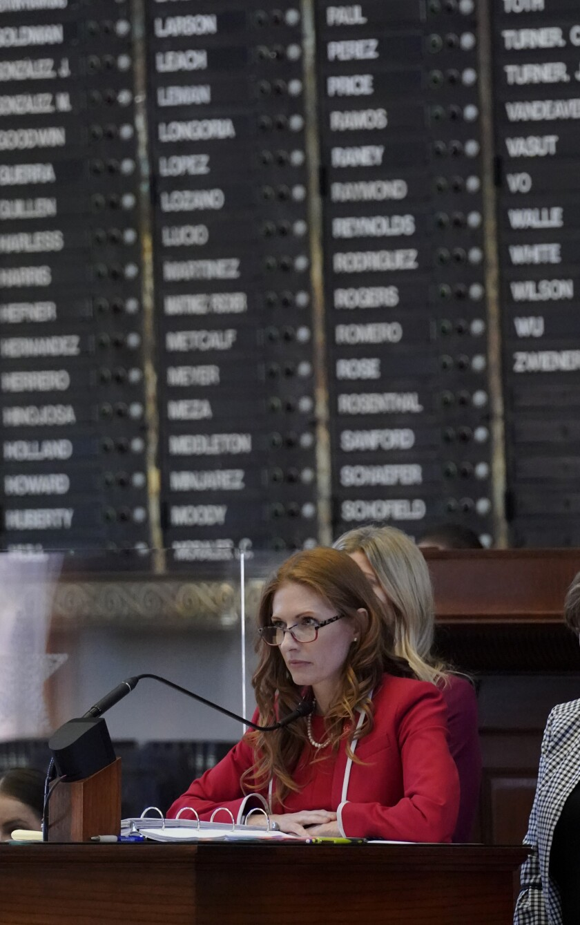 """Texas State Rep. Shelby Slawson, R-Stephenville, center, answers questions about a proposed bill in the House Chamber, Wednesday, May 5, 2021, in Austin, Texas. Slawson is co-sponsoring a bill introduced in Texas that would ban abortions as early as six weeks and allow private citizens to enforce it through civil lawsuits, under a measure given preliminary approval by the Republican-dominated state House on Wednesday. The move would have Texas join about a dozen other Republican-led states to pass so-called """"heartbeat bills"""" which have been mostly blocked by federal courts. (AP Photo/Eric Gay)"""