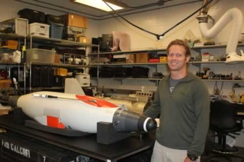 steve sessions with one of the underwater vehicles used in his studies. Ashley Mackin