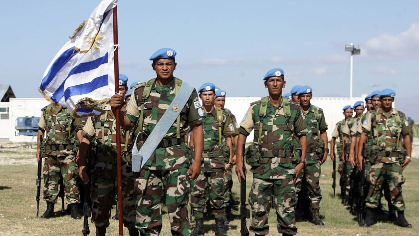 This January 2006 photo shows soldiers from Uruguay, who are among the peacekeepers of the United Nations Stabilization Mission, MINUSTAH, in Haiti.