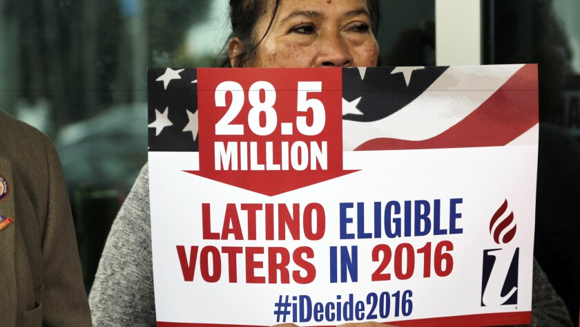 Latino activists divided over Clinton and Sanders