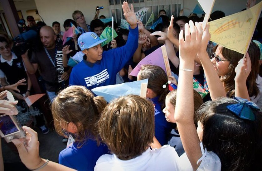 Park View All Stars Little League shortstop Andy Rios is greeted back at St. Pius X school. (NELVIN C. CEPEDA / Union-Tribune)