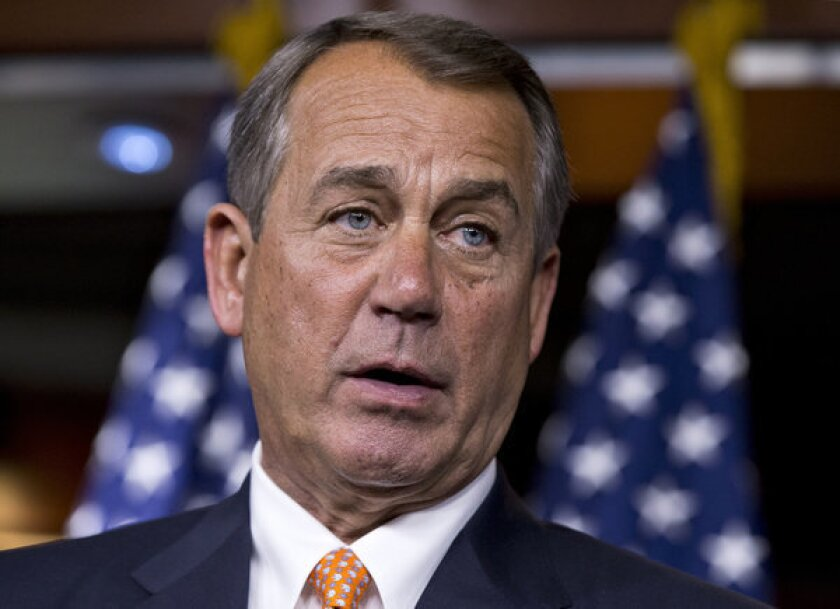 House Speaker John Boehner of Ohio talks to reporters on Capitol Hill in Washington after a closed-door meeting with President Obama to discuss the budget.